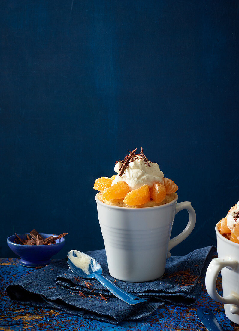 Clementine desserts with cream and grated chocolate