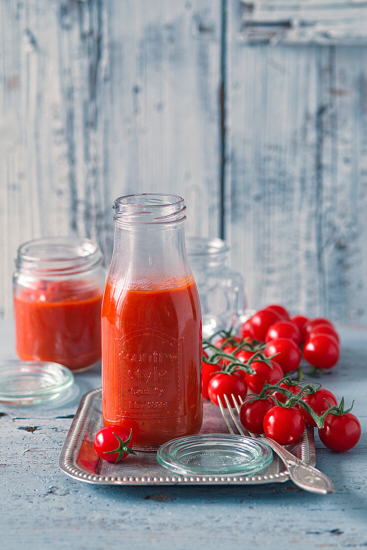 Tomato ketchup and fresh cherry tomatoes