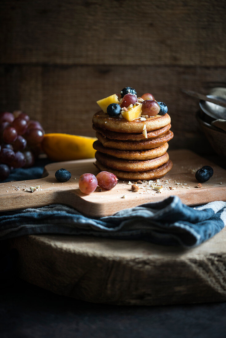 Vegan pancakes with rice syrup, fresh fruit and almonds