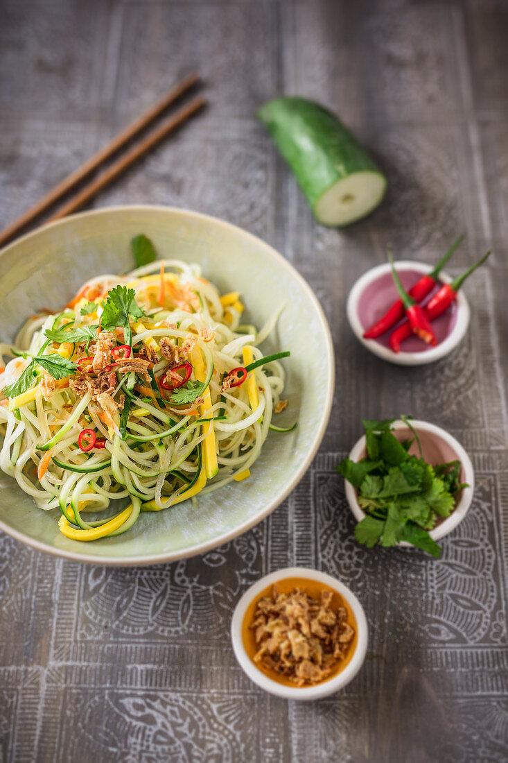 Papaya noodles with mango, coriander and roasted onions (vegan)
