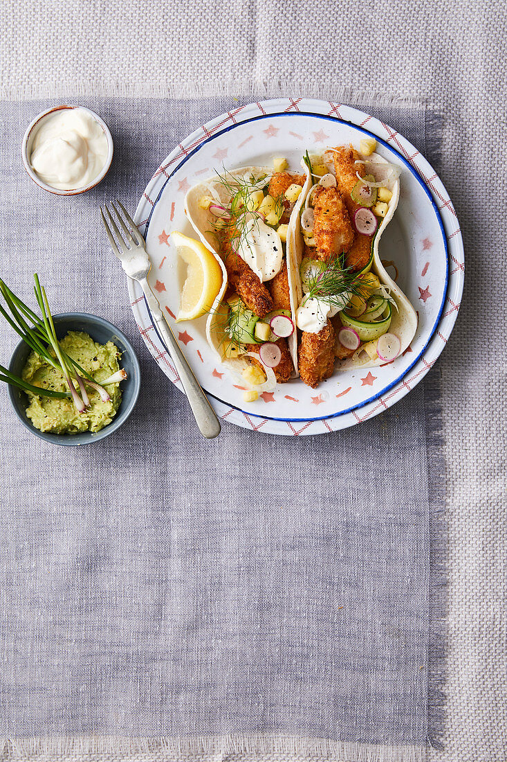 Stuffed tortillas with fried fish, pineapple, fennel and sour cream