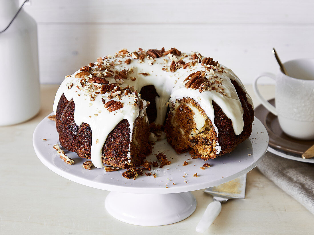 Carrot cheesecake Bundt cake with cream cheese frosting and pecan nuts