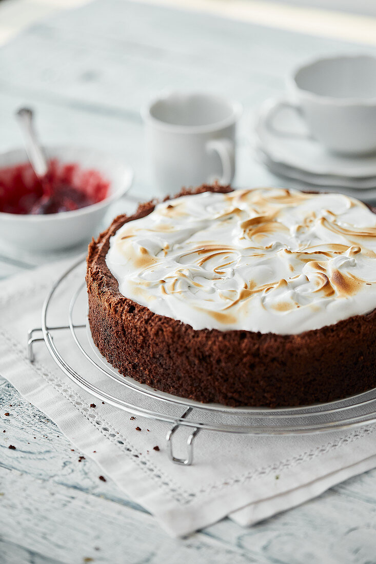 Chocolate, almond and cherry cake with a meringue topping