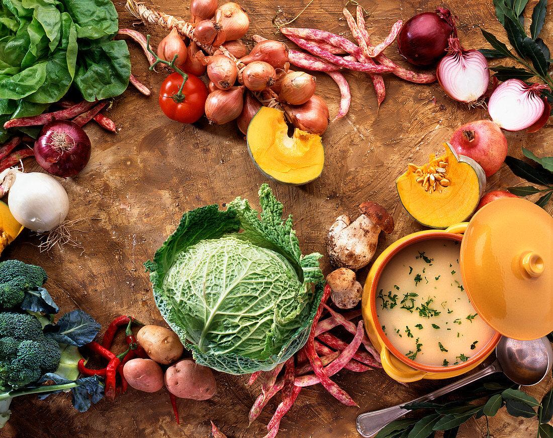 Vegetable soup, fresh vegetables and mushrooms