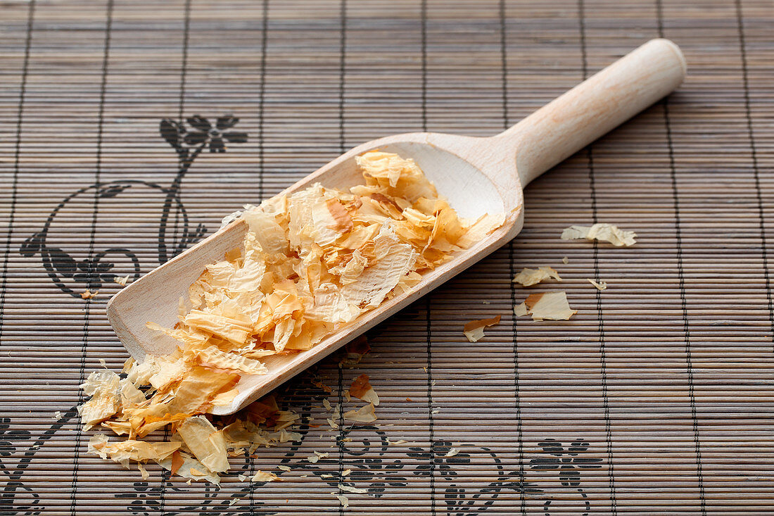 Bonito flakes on a wooden scoop