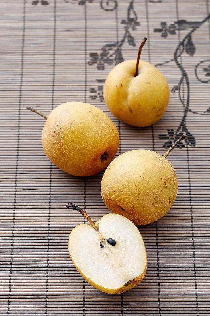 Nashi pears, whole and halved