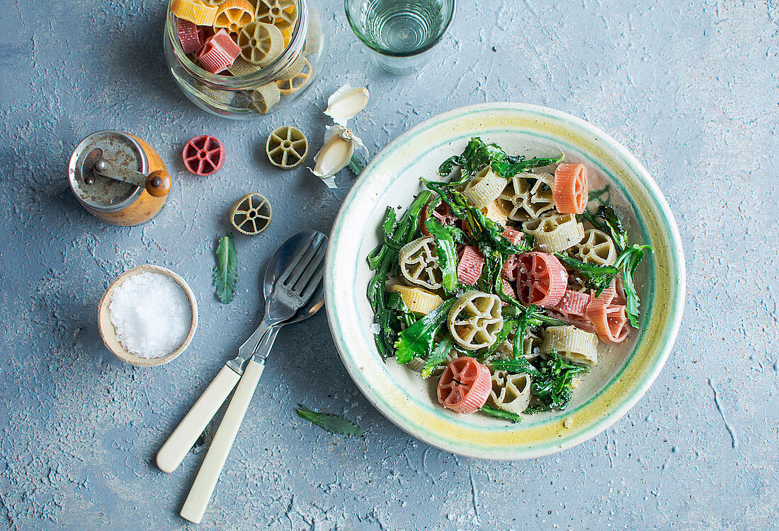 Colourful wheel pasta with vegetables and garlic