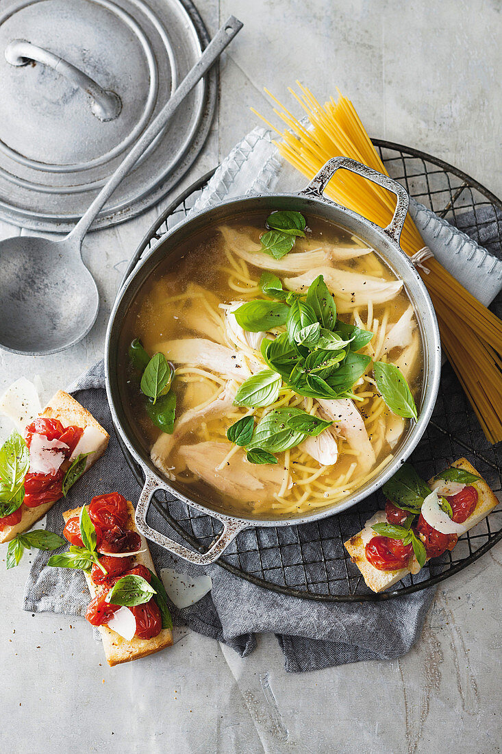 Chicken noodle soup with ciabatta with roasted tomatoes (Italy)
