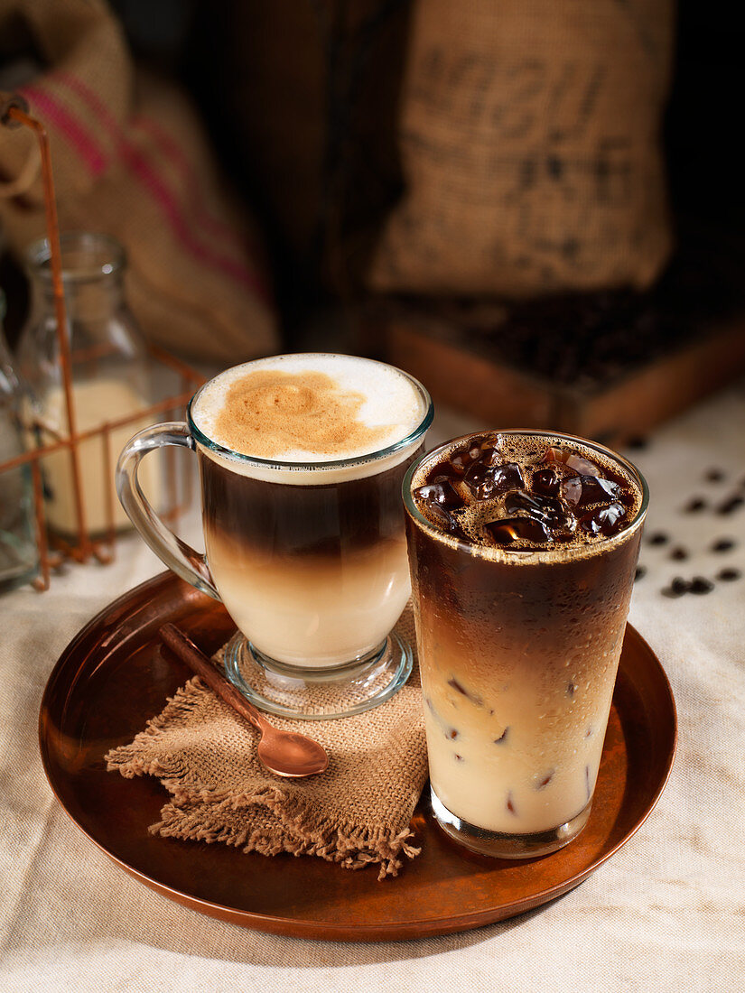 Two coffee drinks on a tray