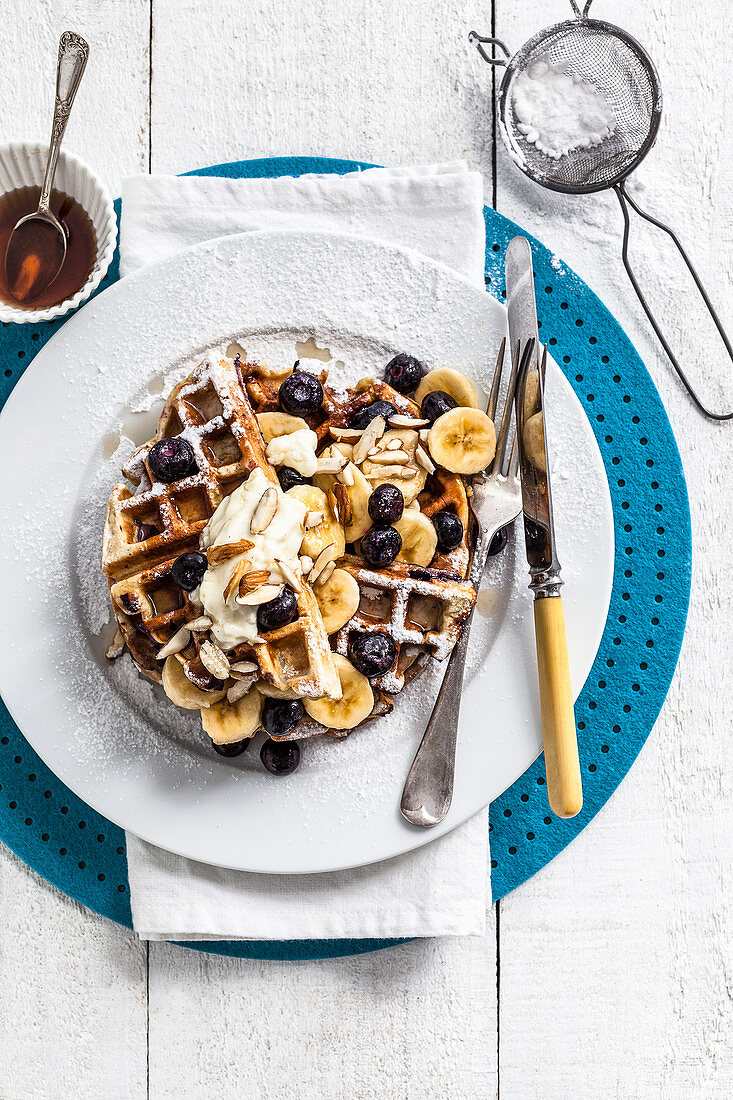 Blueberry and banana waffles with maple syrup