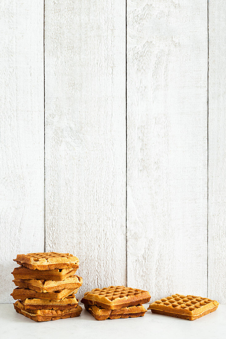 Waffles against a wooden wall