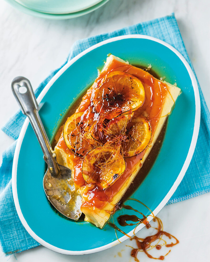Banh Gan (baked Vietnamese vanilla flan) with caramelised orange slices
