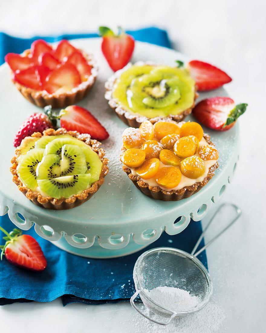Various fruit tarts with vanilla cream