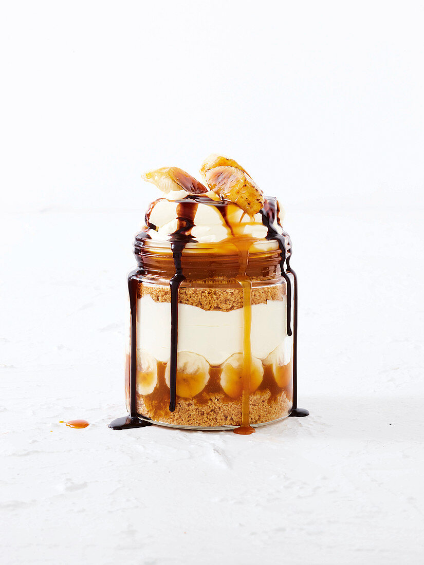 Banoffee with chocolate sauce in a jar