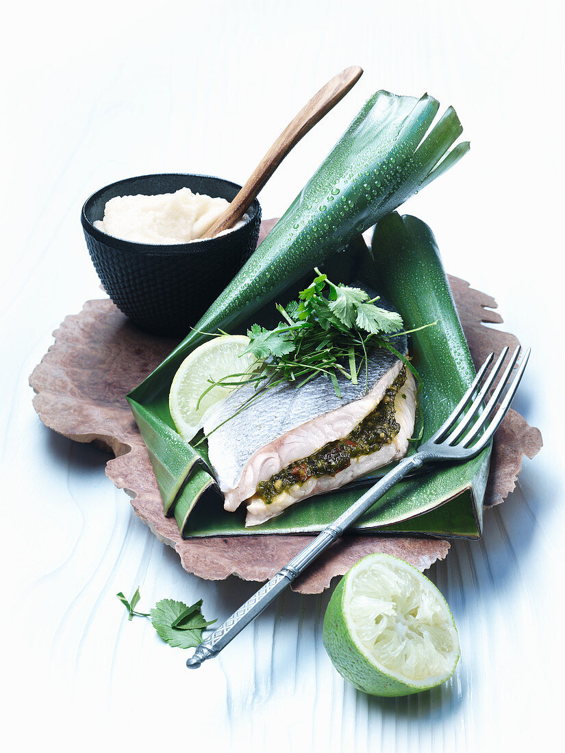 Sea bass in a banana leaf with cauliflower and coconut purée