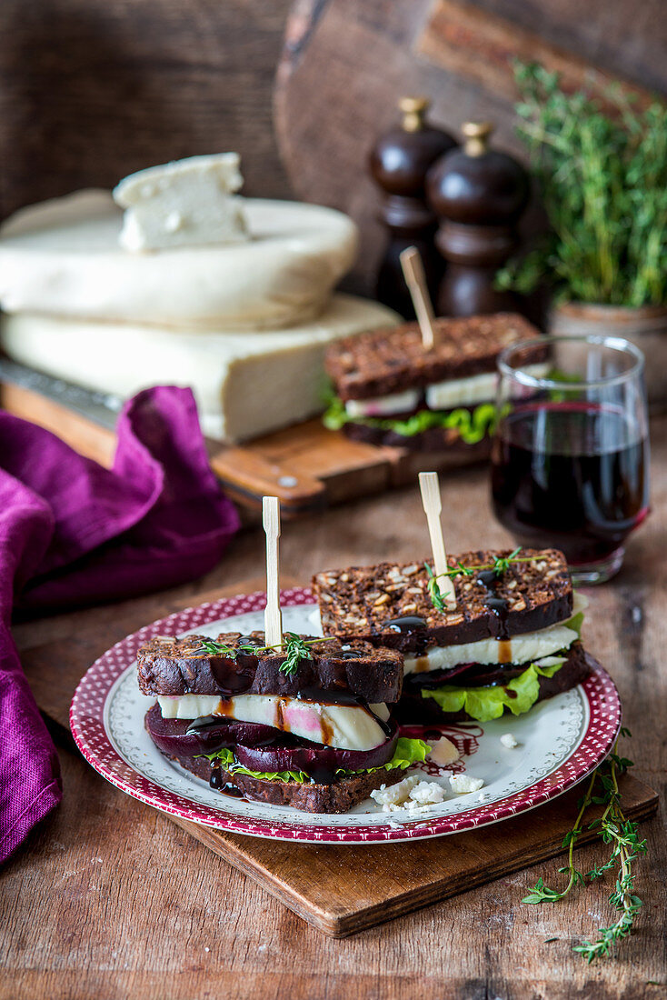 Sandwiches with brown bread, beetroot and goat's cheese