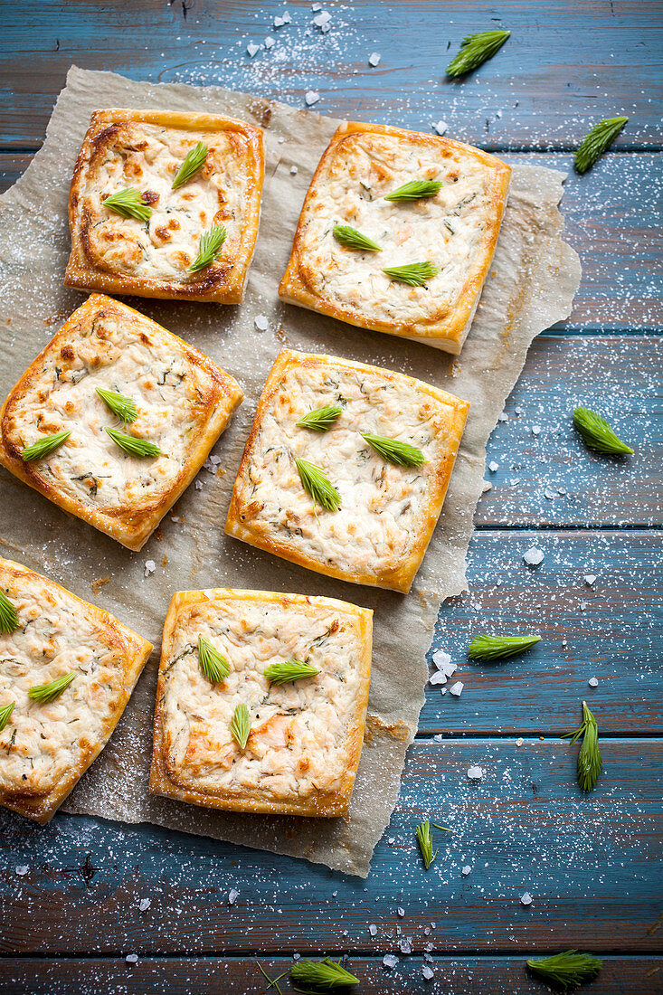 Savory pie with salmon, lemon and spruce tips