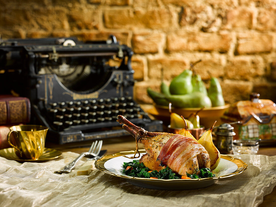 Partridge wrapped in bacon with fried pears