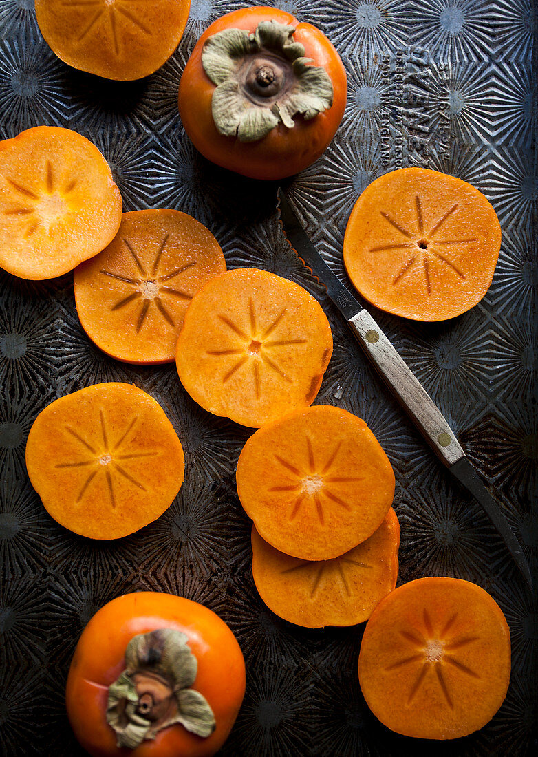 Persimmons, whole and sliced