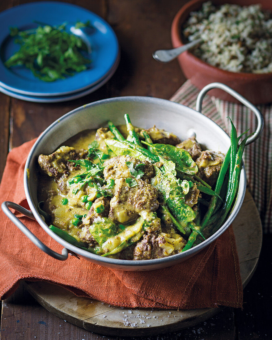 Ostrich curry with coconut milk and green vegetables