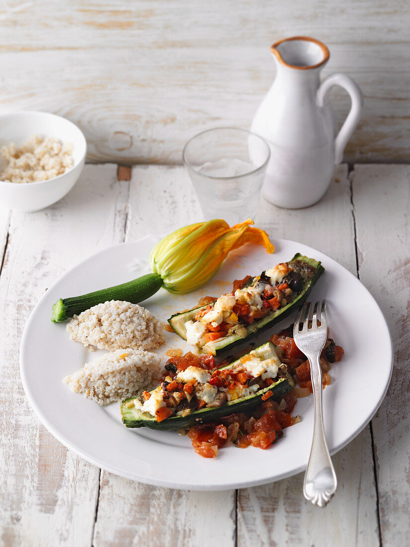 Stuffed courgette with feta cheese and tomatoes served with millet