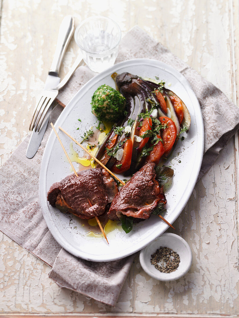 Ostrich saltimbocca with fanned aubergine and falafel