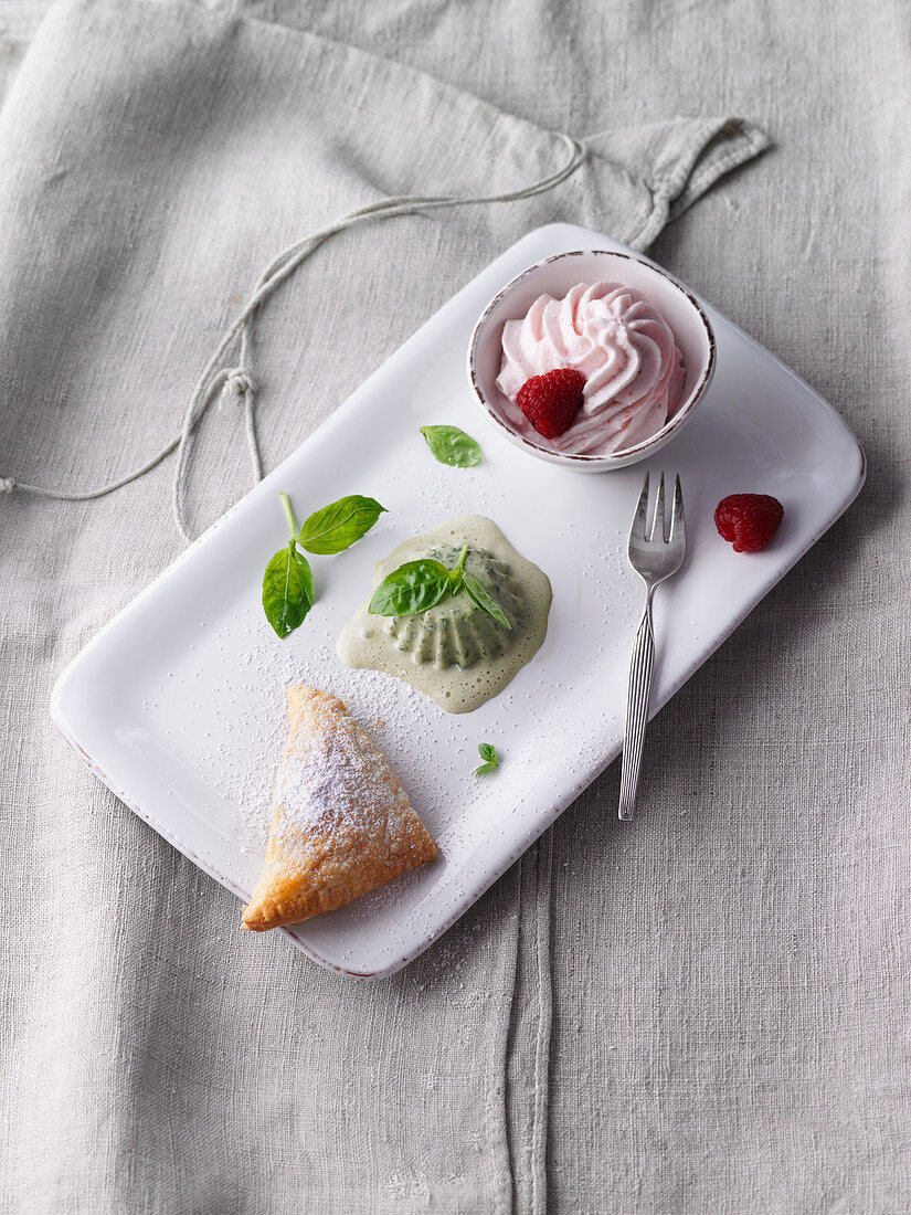 Raspberry foam with basil ice cream and puff pastries