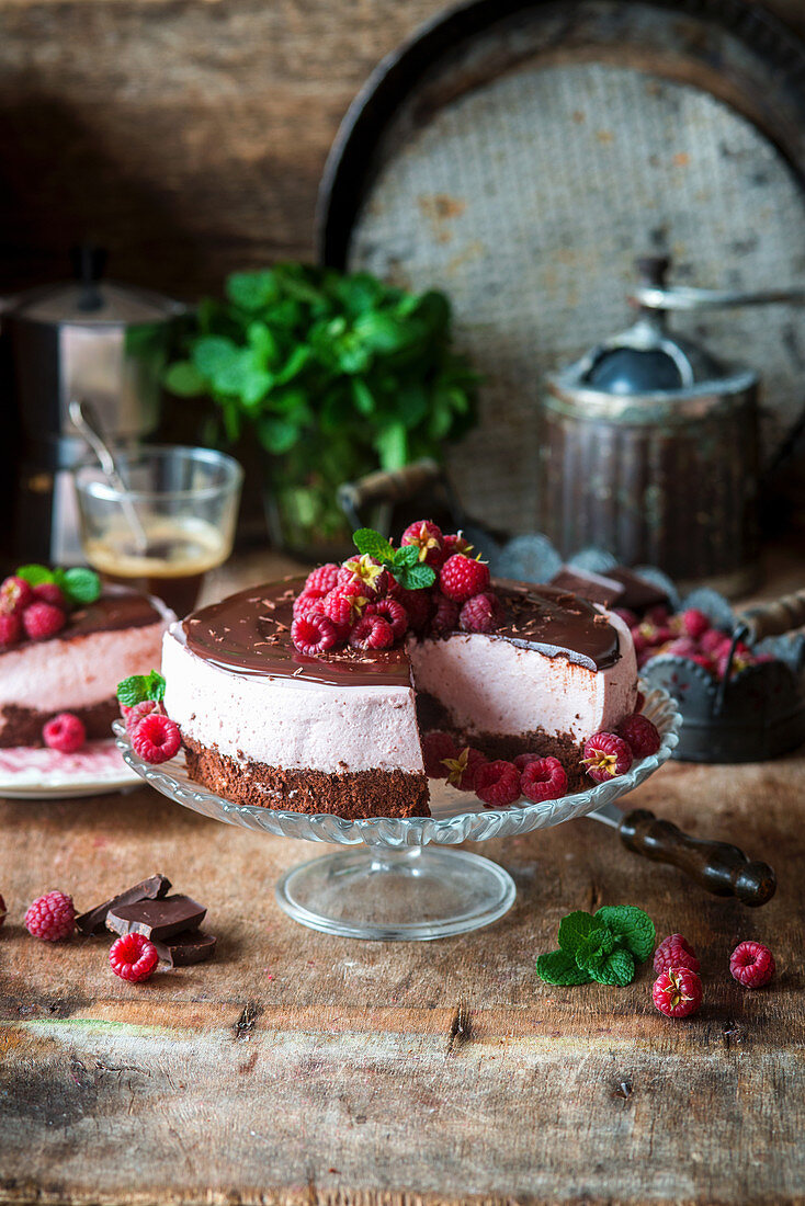Chocolate cake with raspberry mousse, and a slice removed