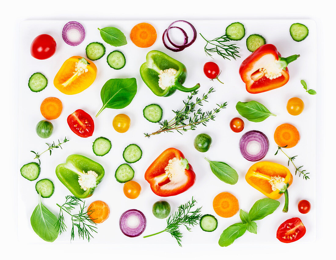 Composition of Fresh organic vegetables (pepper, onion, cucumber, carrot, tomatoe), herbs, olive oil and vinegar