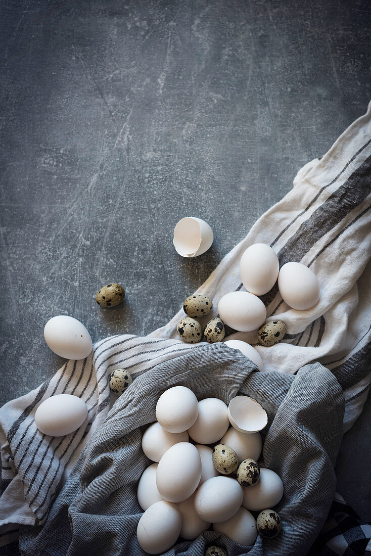 White eggs in a grey cloth linen