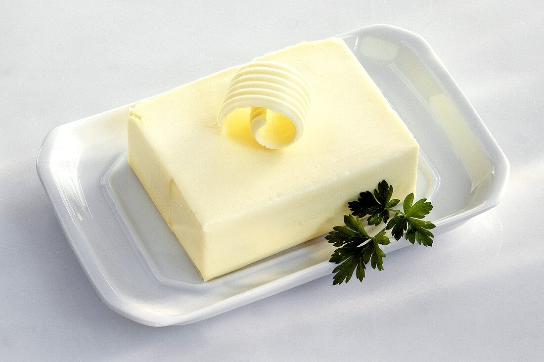 Butter on a Butter Dish with a Butter Curl