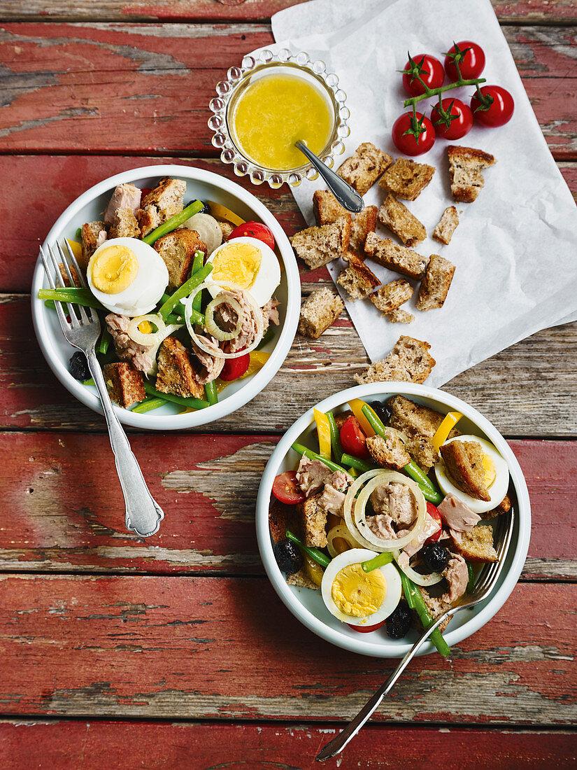 Bread salad à la nicoise with egg and tuna fish