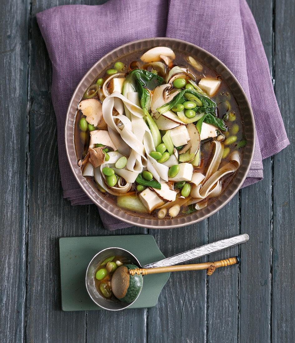 Rice noodle soup with bok choy, edamame and silken tofu