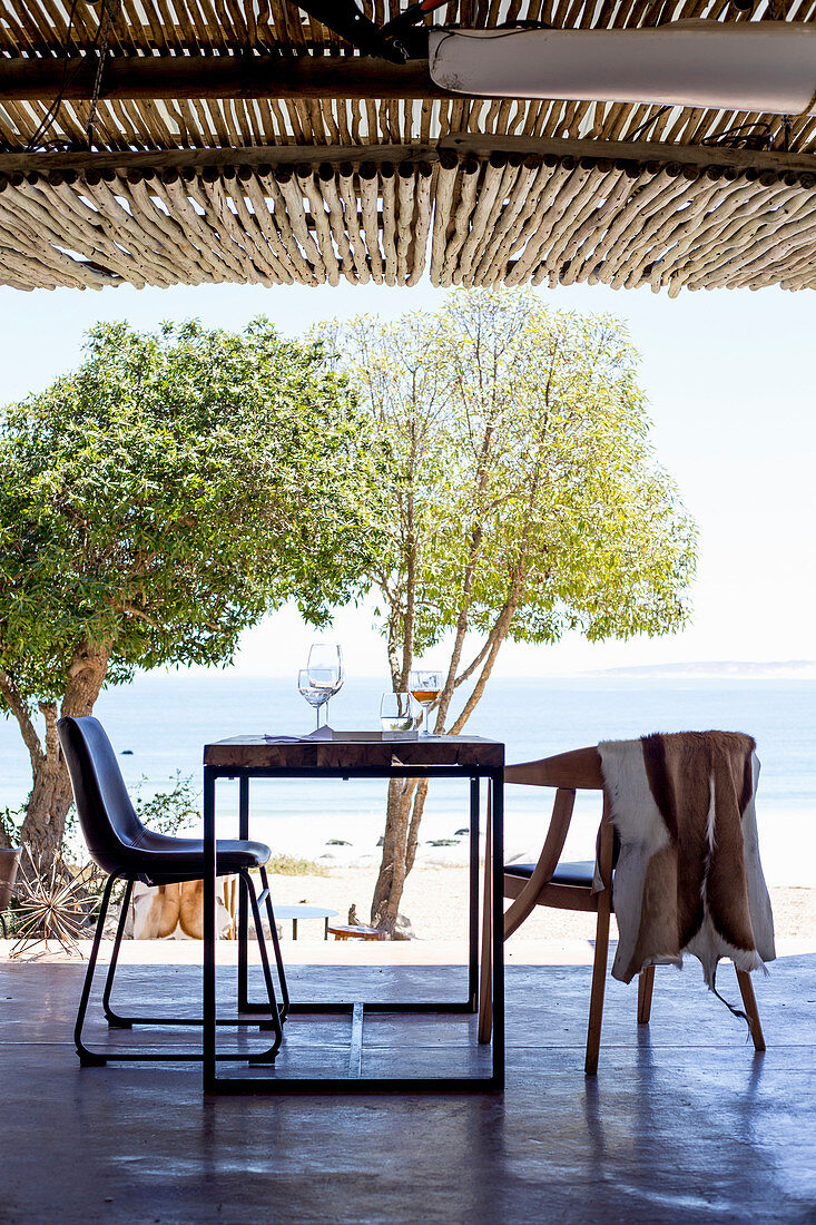 A restaurant table on a terrace with a sea view (South Africa)