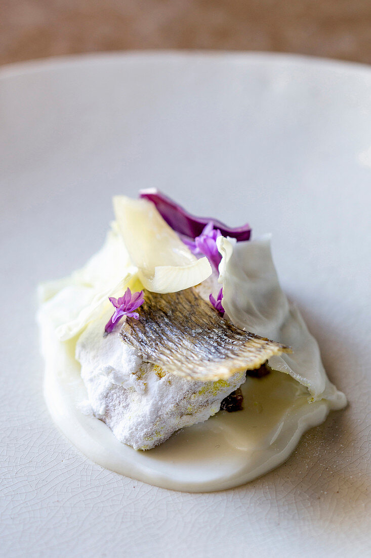 Boiled fish in wild garlic masala with creamy coconut milk powder and sambal (South Africa)