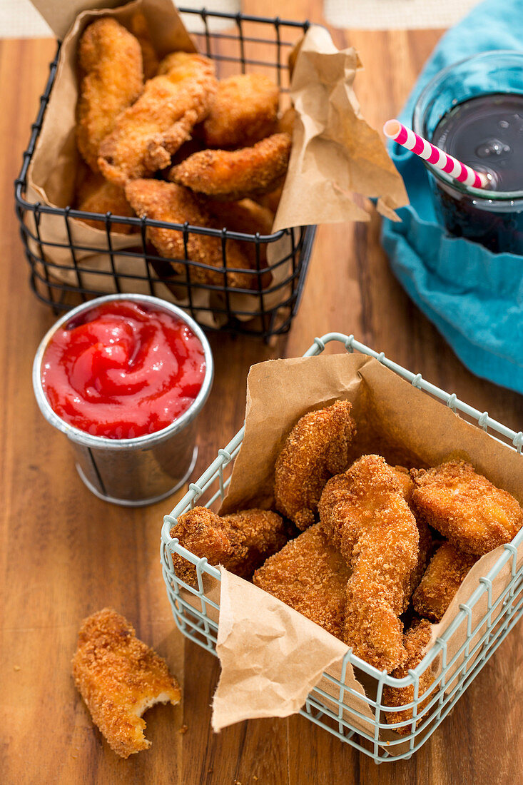 Gluten-free chicken nuggets, ketchup and cola