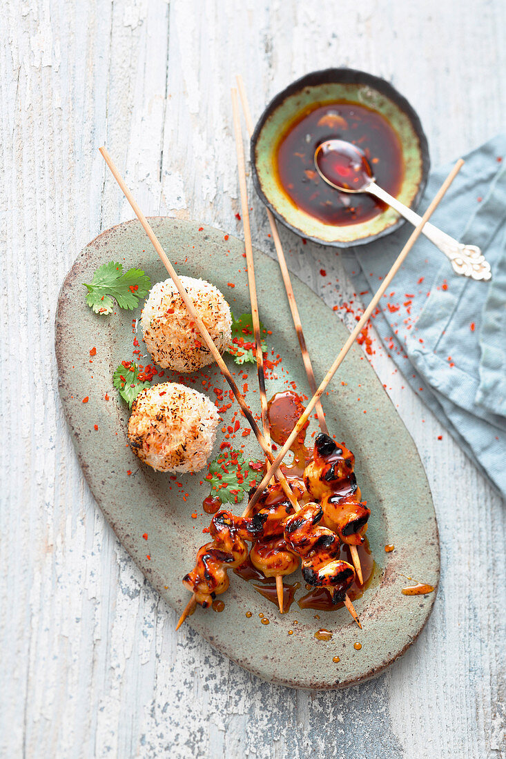 Grilled Teriyaki chicken satay with spicy rice balls