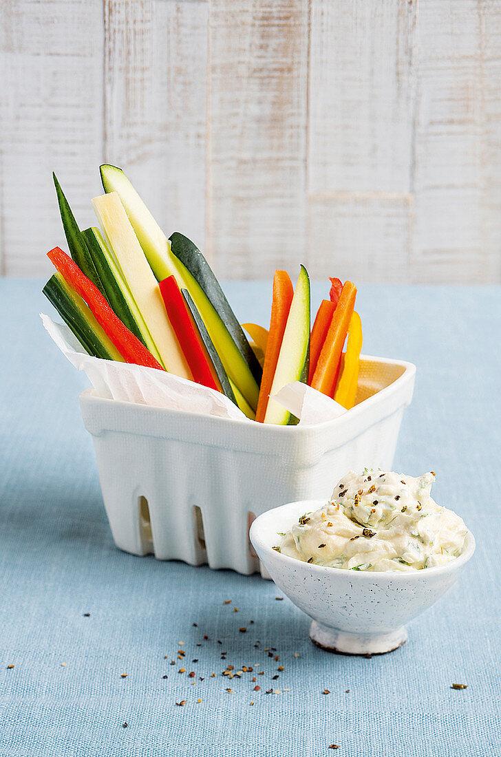 Raw vegetable sticks with a hummus quark dip