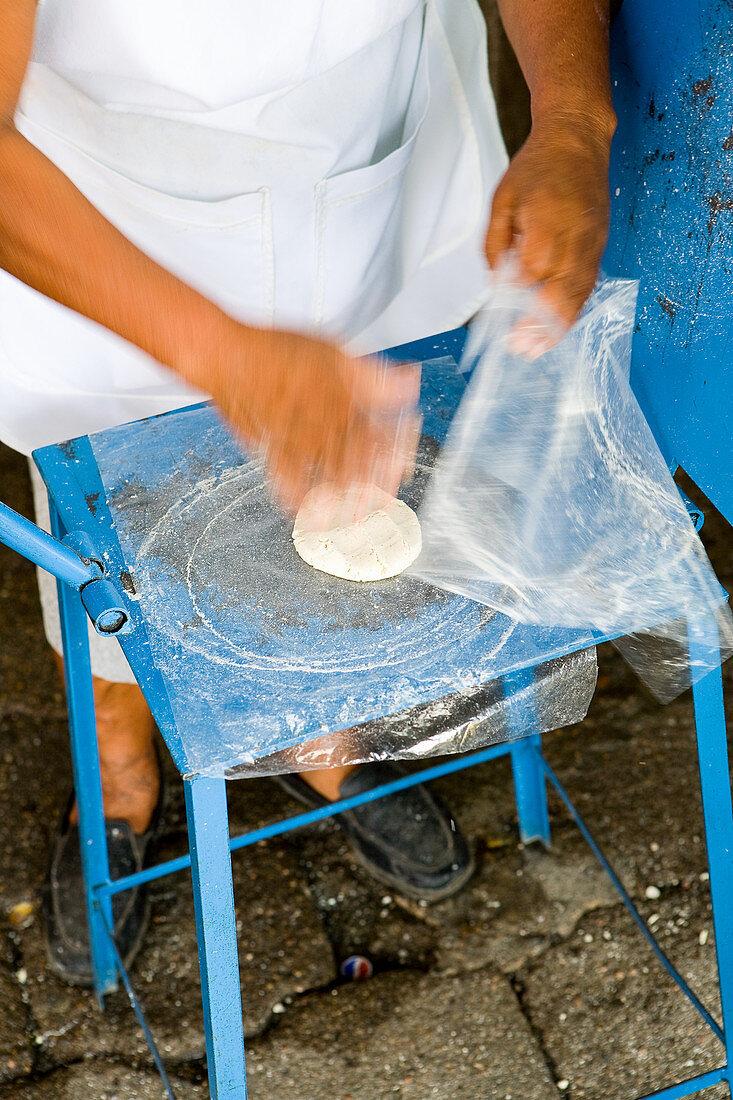 Making tortillas at Etla Market in Oaxaca de Juarez, Mexico