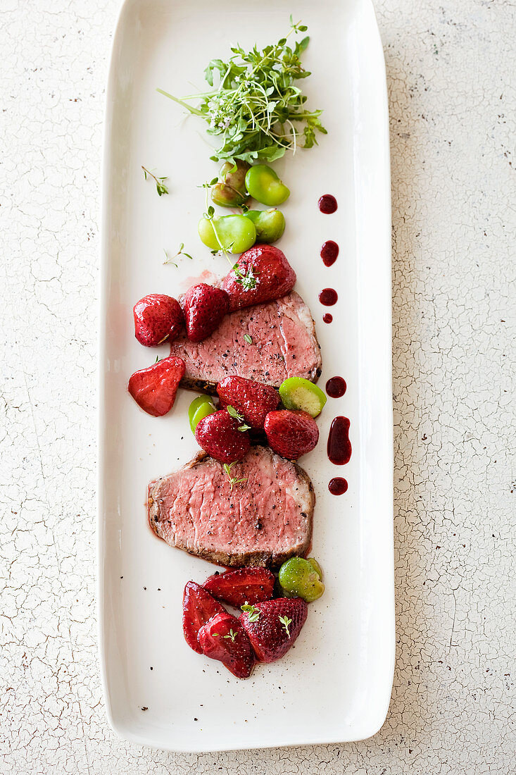Sliced beef tenderloin with caramelized strawberries