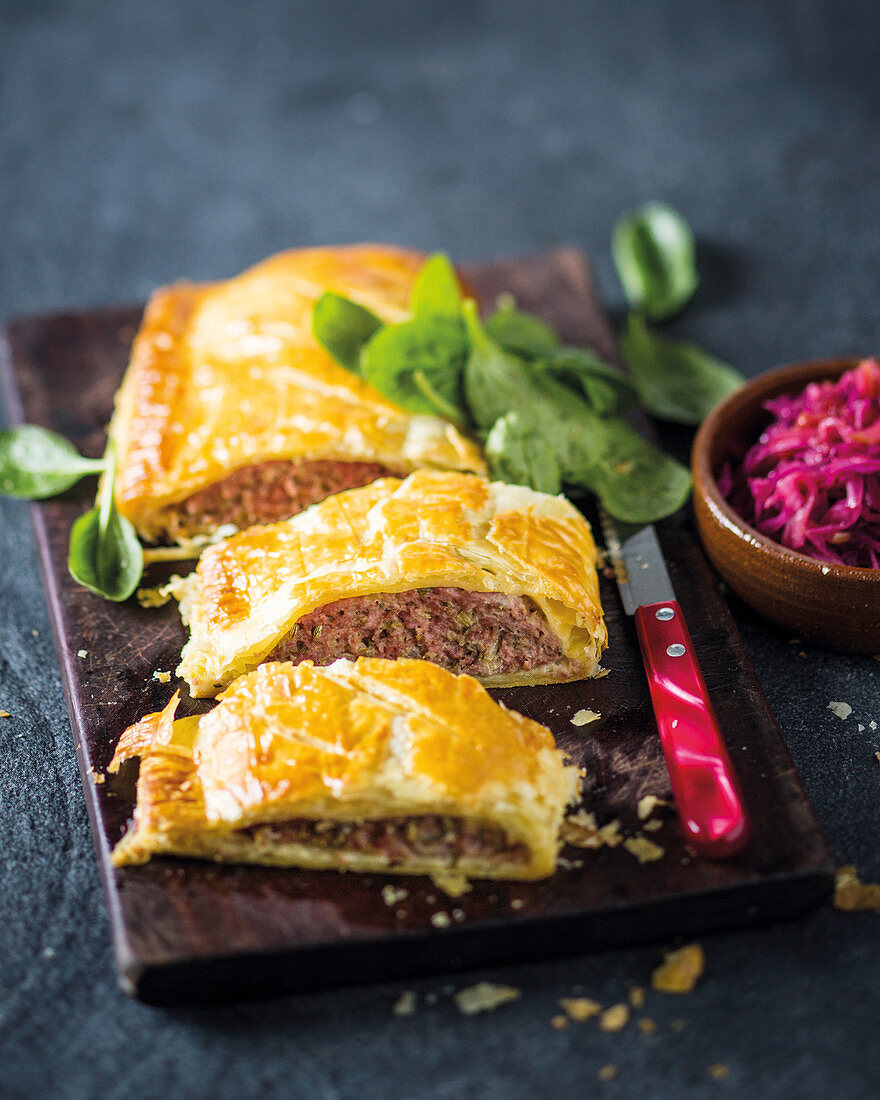 Family-sized pork sausage roll with sautéed cabbage