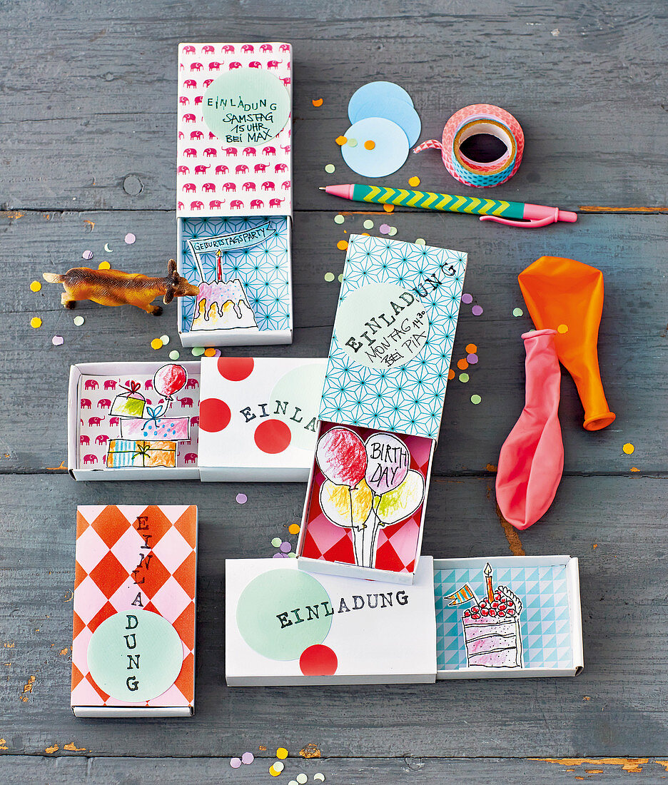 Birthday party invitations in matchboxes