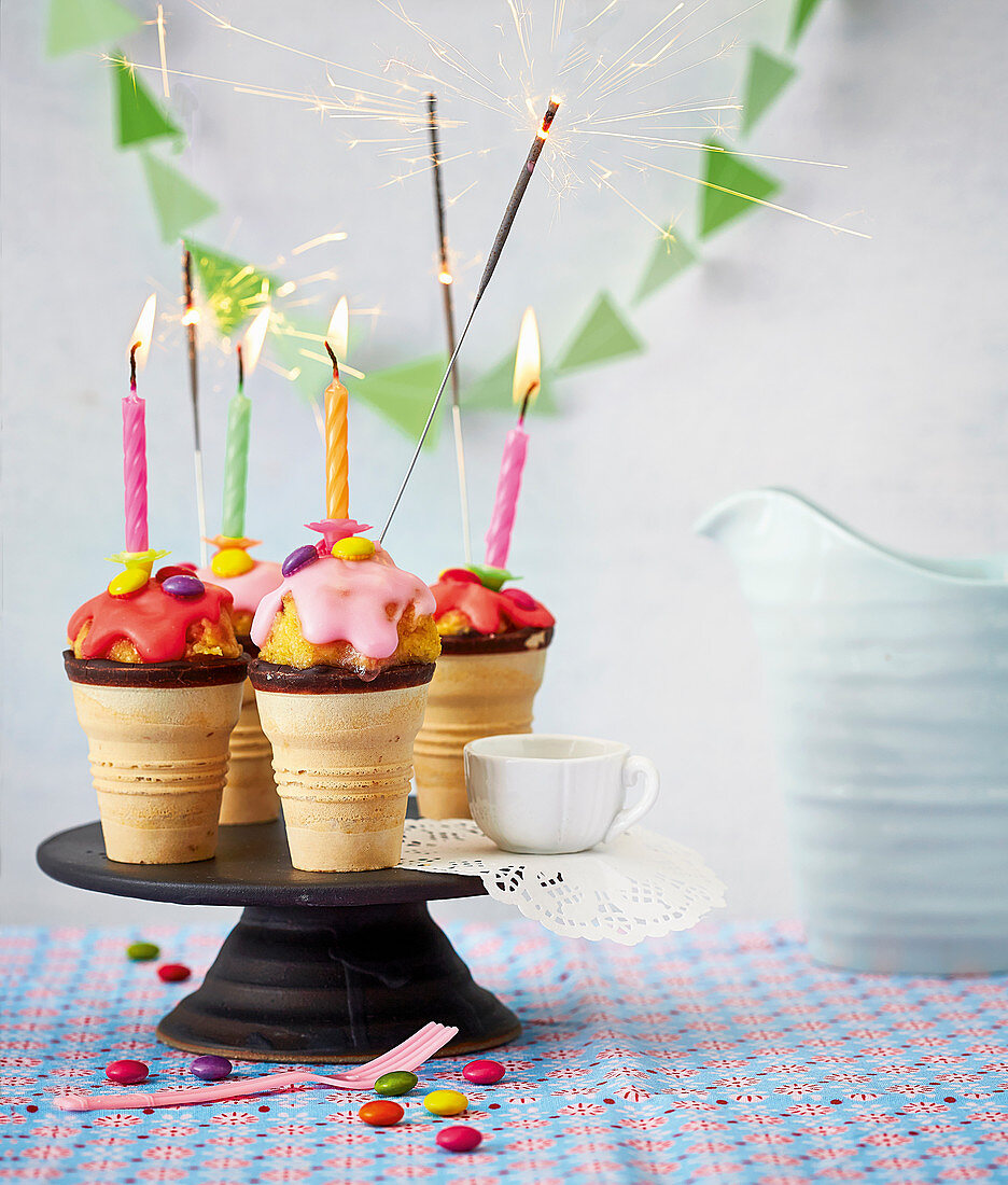 Cake pop ice cream cones with burning sparklers