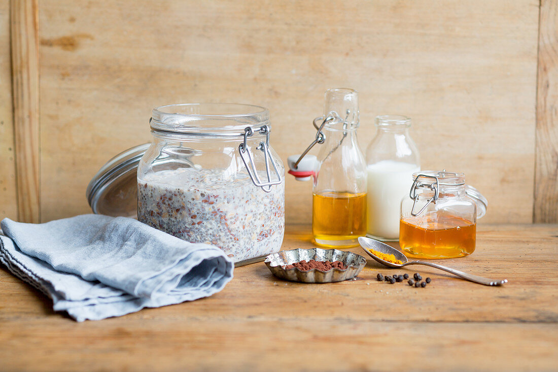 Overnight oats in a jar next to the ingredients