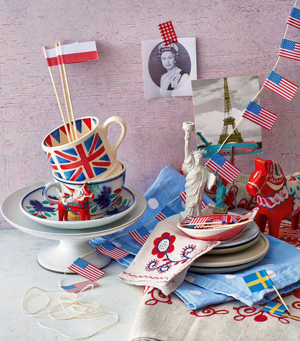 British, Swedish, Polish and American flags, crockery with flag prints, a picture of the Eiffel Tower and the Queen
