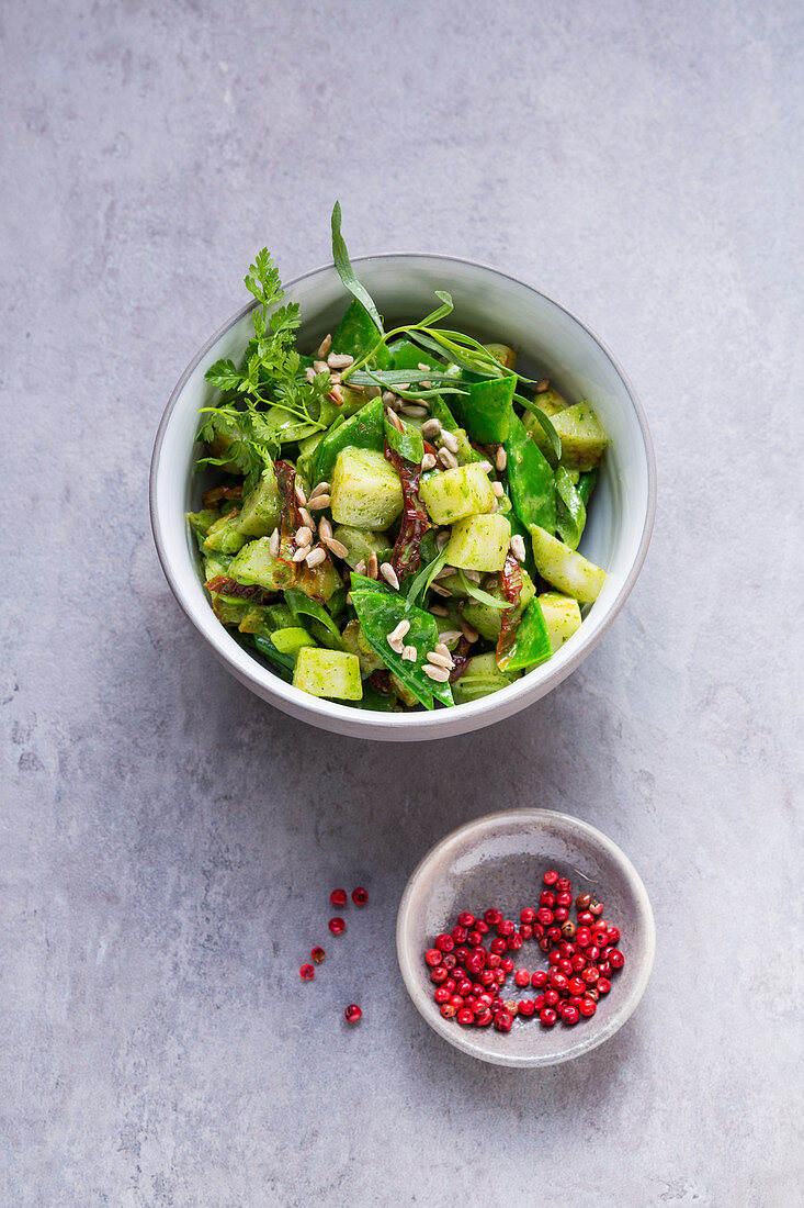 Green Jerusalem artichoke salad with mange tout and a herb dressing