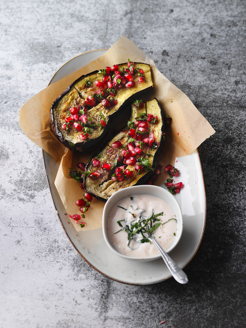 Baked aubergines with pomegranate and a mint soya dip