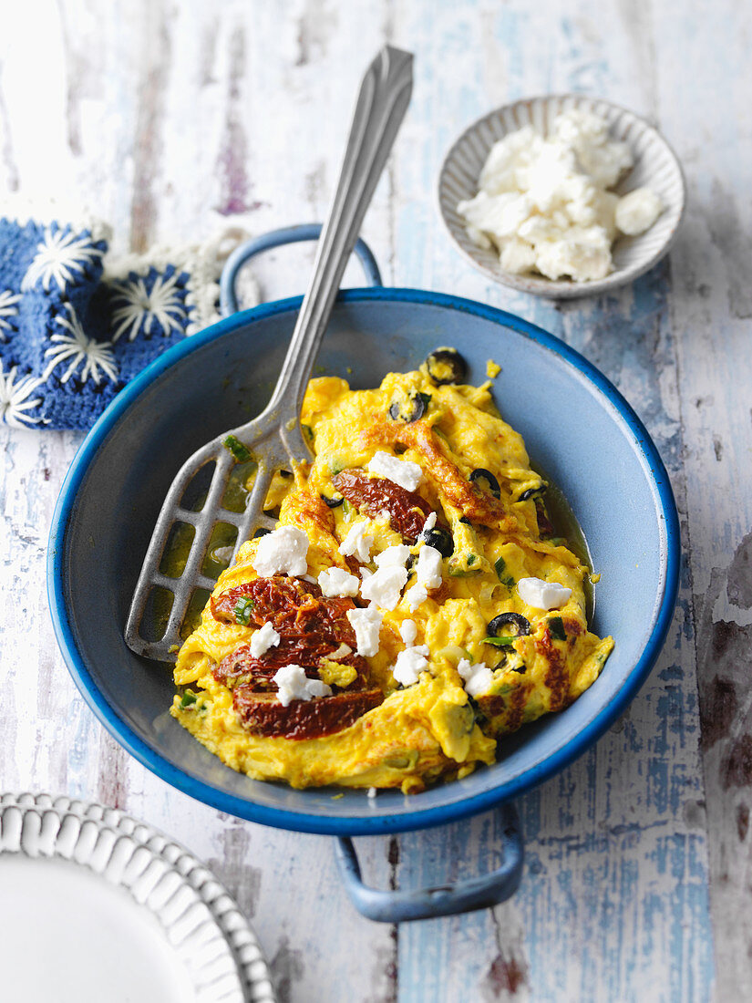 Greek-style scrambled egg with dried tomatoes and feta cheese