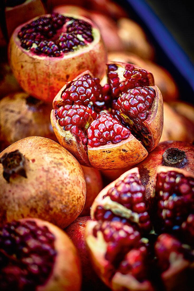 Sliced pomegranates at a market