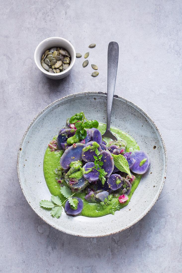 Purple potato salad on green sauce